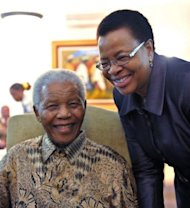 "A handout photo provided on May 16, 2011 by the South African government shows former president Nelson Mandela and his wife Graca Machel in Johannesburg. Machel has thanked the world for its messages of support for the ailing anti-apartheid icon which she said had eased ""the burden of anxiety"""