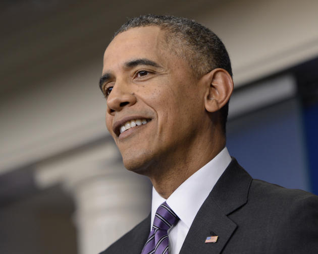 President Barack Obama smiles as he speaks in the briefing room of the White House in Washington, Thursday, April 17, 2014. The president spoke about health care overhaul and the situation in Ukraine.