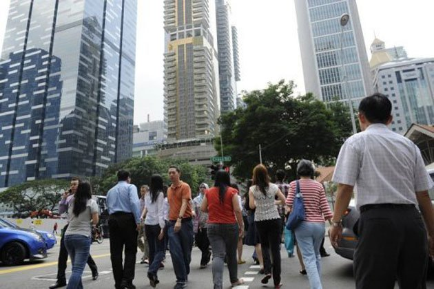 Number of Singaporeans and permanent residents forming part of Singapore's labour force grew in 2012. (AFP photo)