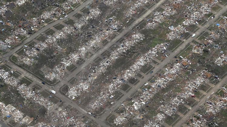 An aerial view of an entire neighborhood destroyed by Monday's tornado is shown Tuesday, May 21, 2013, in Moore, Okla. At least 24 people, including nine children, were killed in the massive tornado that flattened homes and a school in Moore, on Monday afternoon. (AP Photo/Tony Gutierrez)