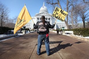Rich Yaeger protests outside of the capitol in Madison, Wisconsin. Photo: Scott Olson/Getty Images