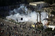 Riot police fire tear gas on Cairo's Tahrir Square during clashes with protesters. A divisive panel boycotted by liberals and Christians was set to rush out a draft new Egyptian constitution on Wednesday as protests mounted over the political future nearly two years after Hosni Mubarak's overthrow