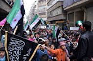 Syrian anti-regime protesters rally in the northern city of Aleppo on February 8, 2013. US Secretary of State John Kerry said that the United States is exploring ways to end Syria's increasingly bloody conflict as the White House defended its refusal to arm rebels there