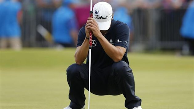 Adam Scott of Australia reacts after a missed putt on the 18th hole during the final round of the Open Championship (Reuters)