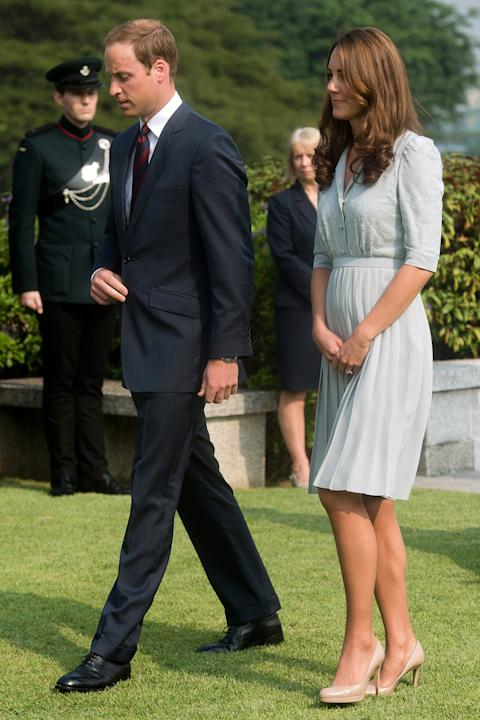 FILE - In this Thursday, Sept. 13, 2012 file photo, Britain's Prince William and his wife Kate, the Duke and Duchess of Cambridge, walk together as they visit the Kranji Commonwealth War Memorial in S