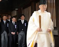 Japanese Land and Transport Ministedr Yuichiro Hata (3rd L) and lawmakers follow a Shinto priest during a visit to the controversial Yasukuni shrine to honour the dead on the 67th anniversary of Japan's surrender in World War II, in Tokyo, on August 15. The visit is likely to provoke outrage in China and South Korea