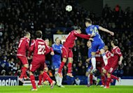 Chelses defender Gary Cahill powers home a header in the UEFA Champions League Group E match against FC Nordsjaelland at Stamford Bridge. Chelsea won 6-1, but Juventus' 1-0 win at Shakhtar Donetsk meant the reigning champions finished third in the group and slipped into the Europa League