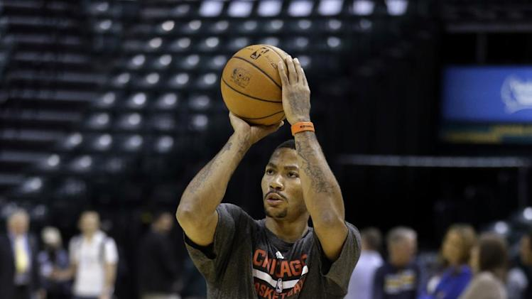 Chicago Bulls guard Derrick Rose shoots before an NBA preseason basketball game against the Indiana Pacers in Indianapolis, Saturday, Oct. 5, 2013