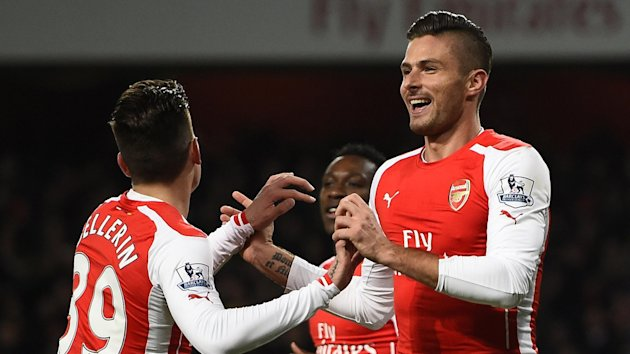 Olivier Giroud (R) celebrates a goal with team-mate Hector Bellerin (Reuters).