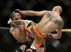Donald Cerrone lands a kick to John Makdessi that ended their fight. (AP)