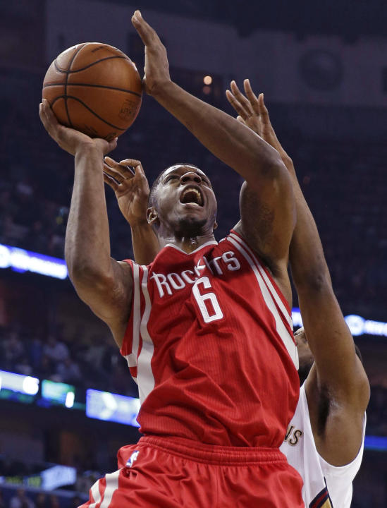 Houston Rockets forward Terrence Jones (6) goes to the basket in the first half of an NBA basketball game against the New Orleans Pelicans in New Orleans, Wednesday, April 16, 2014