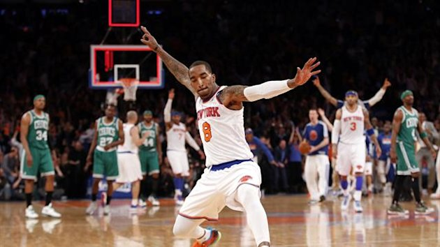 New York Knicks' J.R. Smith celebrates after sinking a three point basket at the buzzer at the end of the first quarter against the Boston Celtics in Game 2 of their NBA Eastern Conference basketball playoff series in New York, April 23, 2013 (Reuters)
