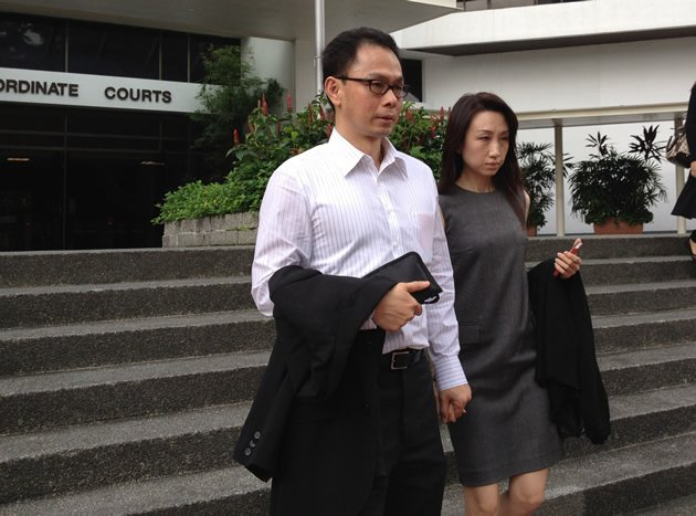 Former CNB director Ng Boon Gay exits the Subordinate Courts on Wednesday after his third day testifying on the stand with his wife. (Yahoo! photo)
