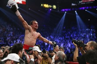 Juan Manuel Marquez celebrates his win over Manny Pacquiao. (AP)
