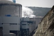 White smoke appearing at the Penly nuclear power plant, in Penly, France. Radioactive cooling fluid leaked at a French nuclear reactor Thursday following two small fires, but the spillage was safely collected in special tanks, officials said