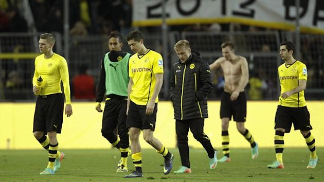 Borussia Dortmund's players leave the field after the German first division Bundesliga soccer match against Hertha Berlin in Dortmund December 21, 2013 (Reuters)