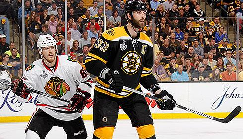 Boston Bruins captain Zdeno Chara battles Chicago Blackhawks winger Andrew Shaw in the 2013 Stanley Cup Final