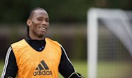 "Football star Didier Drogba (pictured in May) will arrive in China on July 13 ""at the latest"" to join Shanghai Shenhua, the team's coach said on Friday, amid huge anticipation he will help turn the club's season around"