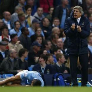 Manchester City manager Manuel Pellegrini reacts after Aguero was fouled during their English Premier League soccer match against Sunderland at the Etihad stadium in Manchester