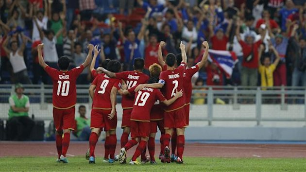 Thailand's players celebrate