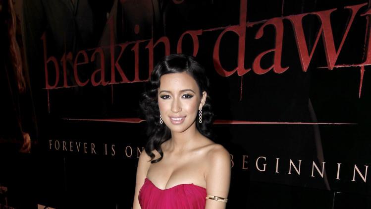 "Christian Serratos arrives at the world premiere of ""The Twilight Saga: Breaking Dawn - Part 1"" on Monday, Nov. 14, 2011, in Los Angeles. (AP Photo/Matt Sayles)"