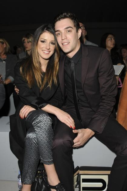 Shenae Grimes and Josh Beech attend the front row for the Unique show on day 3 of London Fashion Week Spring/Summer 2013 at TopShop Venue on September 16, 2012 in London -- Getty Premium