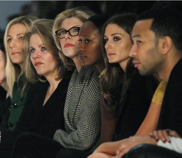 Actress Christine Baranski and singer John Legend watch the Vera Wang Autumn/Winter 2013 collection during New York Fashion Wee