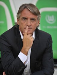 Roberto Mancini, pictured here on August 4, admits Manchester City's Community Shield clash with Chelsea on Sunday has been overshadowed by the transfer row that threatens to derail the Premier League champions before they have even started their title defence