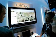Microsoft's Roger Wong (2nd R) demonstrates maps using Bing at the 2010 International Consumer Electronics Show at the Las Vegas Convention Center in 2010 in Las Vegas, Nevada. Microsoft on Friday rolled out a revamped Bing that includes insights from Facebook and Twitter in the biggest overhaul of the search service since its launch three years ago