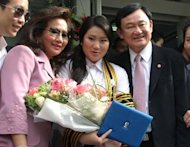 "Ousted Thai premier Thaksin Shinawatra (R) with his ex-wife Pojaman (L) and daughter Paetongtarn in Bangkok in 2008. Cathay Pacific is probing reports a flight attendant threatened to throw coffee at Paetongtarn, after calling the politician an ""enemy"", the airline said Monday"