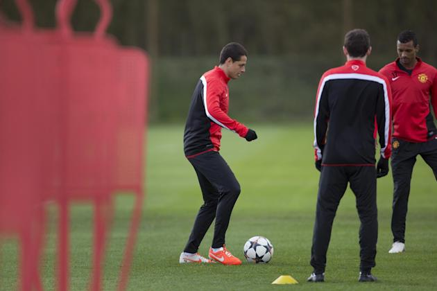 Manchester United's Javier Hernandez trains with teammates at Carrington training ground in Manchester, Tuesday, April 8, 2014. Manchester United will play Bayern Munich in Germany in a Champions
