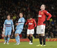 Manchester United striker Wayne Rooney reacts after missing his penalty kick during the third-round replay at home to West Ham United on January 16, 2013. Alex Ferguson called on his Manchester United side to improve their penalty-taking after Rooney's miss was their fifth spot-kick failure of the season