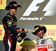 Germany's Sebastian Vettel (L) of Team Red Bull Racing sprays champagne on Britain's Lewis Hamilton (R) of Vodafone McLaren Mercedes after Hamilton won the United States Formula One Grand Prix at the Circuit of the Americas in Austin, Texas. Vettel took second place