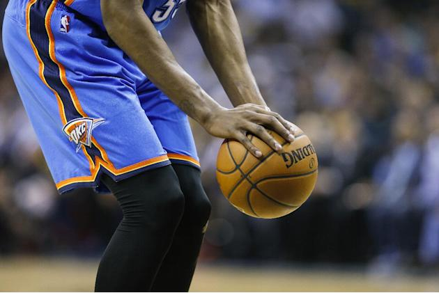 Oklahoma City Thunder forward Kevin Durant shoots a free throw in the second half of Game 3 of an opening-round NBA basketball playoff series against the Memphis Grizzlies Thursday, April 24, 2014, in