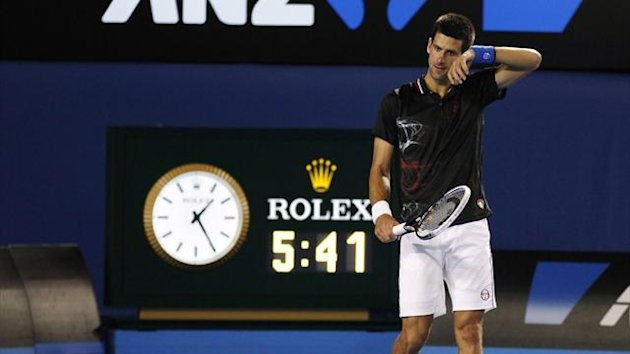 A clock shows the total match time as Novak Djokovic of Serbia plays against Rafael Nadal of Spain during the final at the Australian Open in 2012 (AFP)