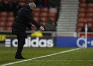 Chelsea manager Jose Mourinho gestures during his side's defeat to Stoke City in their English Premier League soccer match at the Britannia Stadium in Stoke-on-Trent, central England, December 7, 2013. REUTERS/Andrew Winning