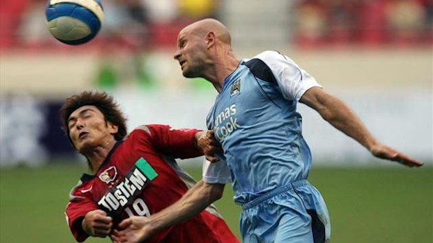 Danny Mills in action for Manchester City during the Shanghai International Football tournament in Shanghai (Reuters)