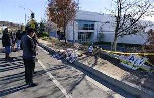 Fans place flowers at the scene of the car crash where actor Paul Walker was killed in the Santa Clarita area of Los Angeles