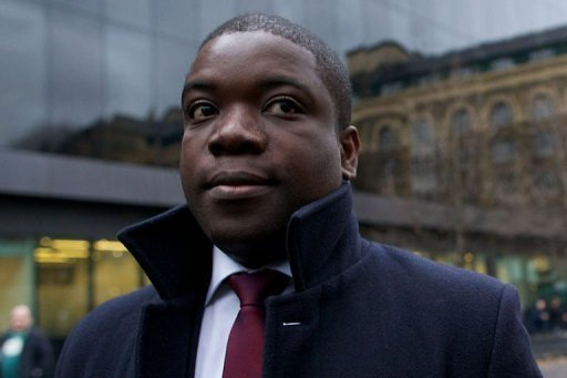 Former UBS banker Kweku Adoboli arrives at Southwark Crown Court in London. Adoboli, who gambled away $2.3 billion of the Swiss bank's money, was convicted of Britain's biggest ever fraud