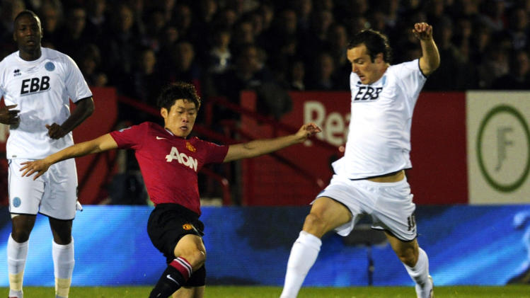Aldershot Town's Danny Hylton, right, is tackled by Manchester United''s Ji-Sung Park during their English League Cup soccer match at the EBB stadium, Aldershot, England  Tuesday, Oct. 25, 2011. (AP Photo/Tom Hevezi)