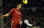Liverpool's Danish defender Daniel Agger (left) beats Newcastle United's forward Demba Ba to the ball during their Premier League match at Anfield, Liverpool, 2011. Liverpool manager Brendan Rodgers said that the Anfield club could be willing to sell Agger if Manchester City meet their asking price