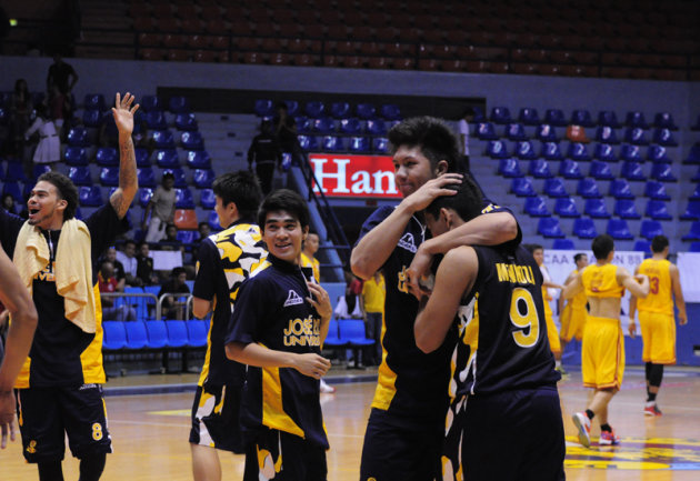 The JRU Heavy Bombers celebrate after beating the SSC Stags, 82-74. (NPPA Images)