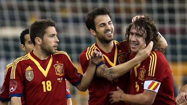 Spain's Cesc Fabregas (C) celebrates with teammates after scoring a goal against Uruguay during their friendly football match in the Qatari capital Doha on February 6, 2013 (AFP)