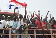 A man holds a French flag and cheers during the inauguration of Mali's new president in Bamako on September 19, 2013