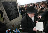 Chief Rabbi of Galicia, Egdar Glueck prays in front of a memorial plaque in the former Nazi concentration camp of Plaszow on March 16, 2008