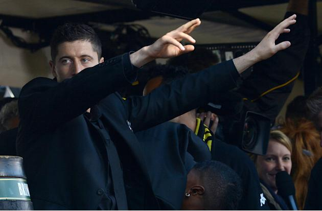 Dortmund's Polish Striker Robert Lewandowski  Celebrates AFP/Getty Images