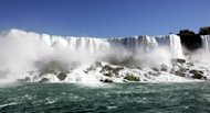 The American portion of Niagara Falls pictured in 2006. Thousands of tourists are expected in Niagara Falls to witness Nik Wallenda walk a tightrope across the famous waterfalls, and the town is hoping to get lucky as well