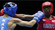 Jamel Herring (R) of the USA exchanges blows with Daniyar Yeleussinov (L) of Kazakhstan during their first round Light-Welterwight (64kg) boxing match of the London 2012 Olympics at the ExCel Arena in London. Yeleussinov was awarded a 19-9 points victory. A