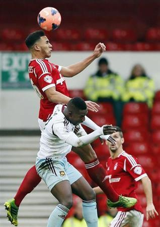 West Ham United's Maiga challenges Nottingham Forest's Lascelles during their FA Cup third round soccer match at the City Ground in Nottingham