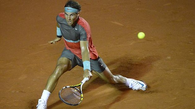 BRAZIL, Rio de Janeiro : Spanish tennis player Rafael Nadal returns the ball to Spanish tennis player Daniel Gimeno Traver during the 2014 Rio Open at the Jockey Club in Rio de Janeiro, Brazil on February 18, 2014. AFP PHOTO